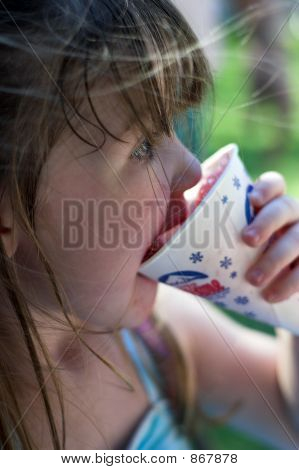 Young Girl Eating A Snow Cone