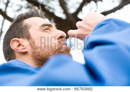 Man drinking water after exercise practice