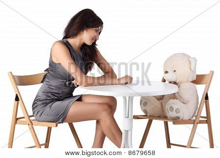 Young Women Looking At Teddy Bear