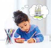 people, childhood, creativity and imagination concept - happy little girl drawing with crayons and dreaming about fairytale castle at home or art school poster