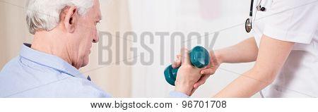 Elder Man Exercising With Dumbbell