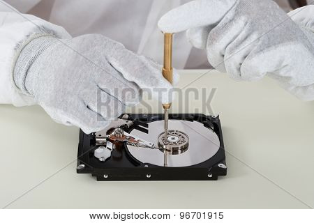 Person Repairing Harddisk Using Screwdriver