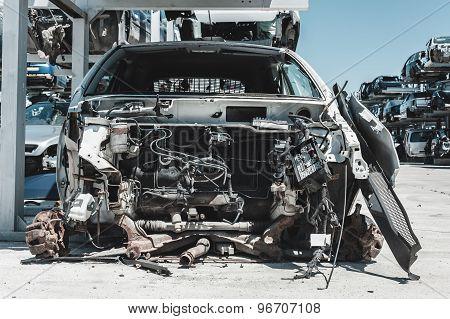 Crashed car in dismantling yard.