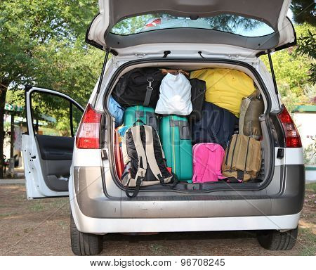 Car Overloaded With Suitcases For Travel