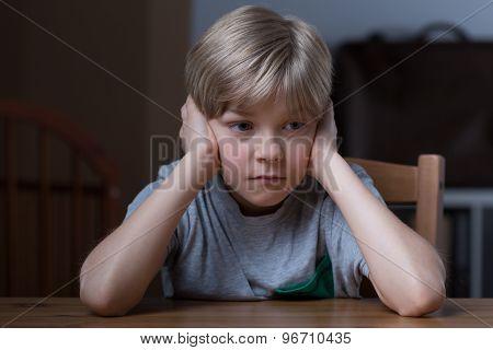 Pouty Boy Covering Ears