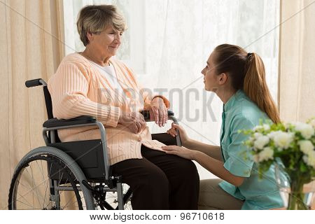 Caregiver Helping Old Female