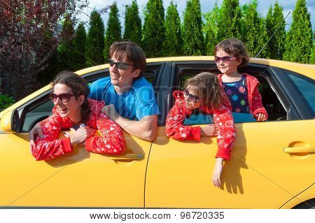 Family car trip on summer vacation, happy parents travel with kids and having fun