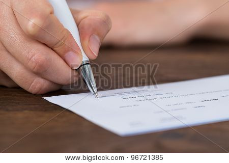 Person Hands Signing Cheque