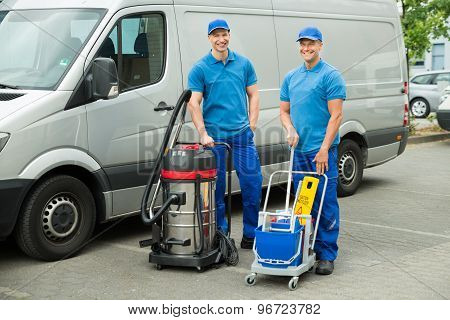 Two Cleaners Standing With Cleaning Equipments