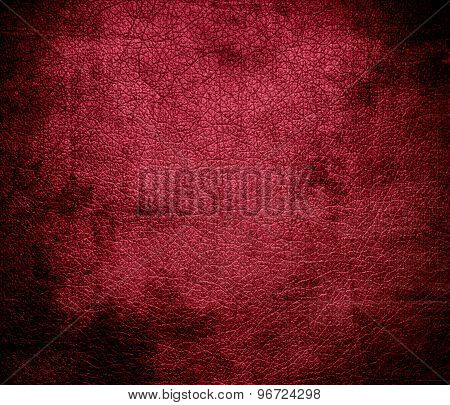 Grunge background of deep carmine leather texture