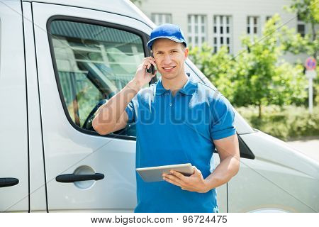 Worker With Mobile Phone And Digital Tablet