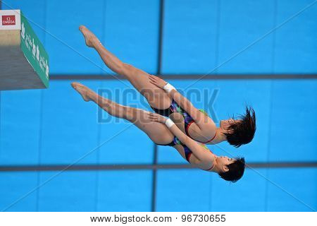 LONDON, GREAT BRITAIN - APRIL 25 2015: Tingmao Shi and Minxia Wu of China competing in the women's synchro 10m platform during the FINA/NVC Diving World Series at the London Aquatics Centre