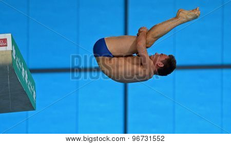 LONDON, GREAT BRITAIN - APRIL 27 2015: Tom Daley of Great Britain competing in the men's 10m platform during the FINA/NVC Diving World Series at the London Aquatics Centre