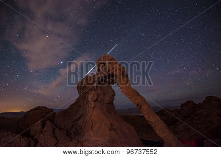 Elephant Rock At Night With Plane Trail Behind