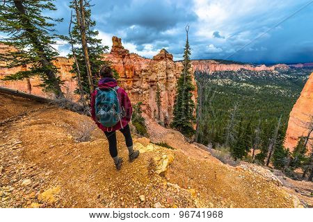 Woman Backpacker Hiking Down The Ponderosa Canyon Bryce National Park