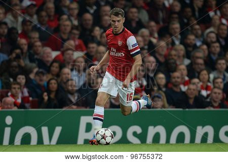 LONDON, ENGLAND - Oct 01 2013: Arsenal's midfielder Aaron Ramsey from Wales runs with the ball during the UEFA Champions League match between Arsenal and Napoli.