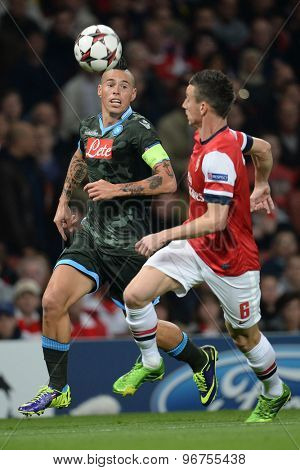 LONDON, ENGLAND - Oct 01 2013: Napoli's midfielder Marek Hamsa­k and Arsenal's defender Laurent Koscielny compete for the ball during the UEFA Champions League match between Arsenal and Napoli.