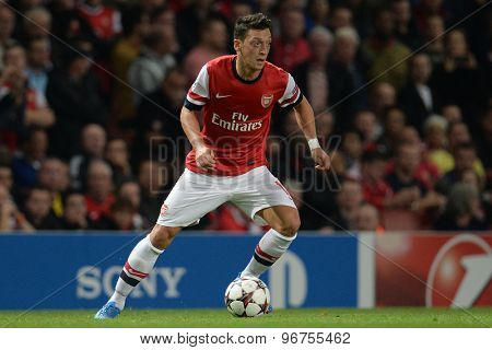 LONDON, ENGLAND - Oct 01 2013: Arsenal's midfielder Mesut Ozil from Germany   during the UEFA Champions League match between Arsenal and Napoli.