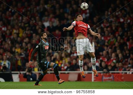 LONDON, ENGLAND - Oct 01 2013: Arsenal's forward Olivier Giroud from France controls the ball during the UEFA Champions League match between Arsenal and Napoli.