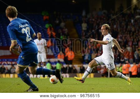 LONDON, ENGLAND - September 19 2013: Tottenham's Christian Eriksen during the UEFA Europa League match between Tottenham Hotspur and Tromso played at The White Hart Lane Stadium.