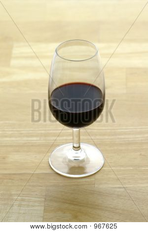 Glass Of Port On Butcher Block Surface