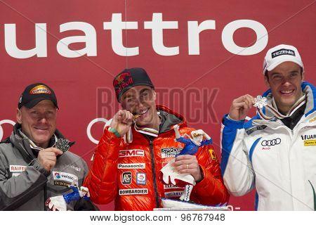 GARMISCH PARTENKIRCHEN, GERMANY. Feb 12 2011: silver medal winner Didier Cuche (SUI) (L) Gold medal winner Erik Guay (CAN) (C) and bronze medal winner Christof Innerhofer (ITA) (R)
