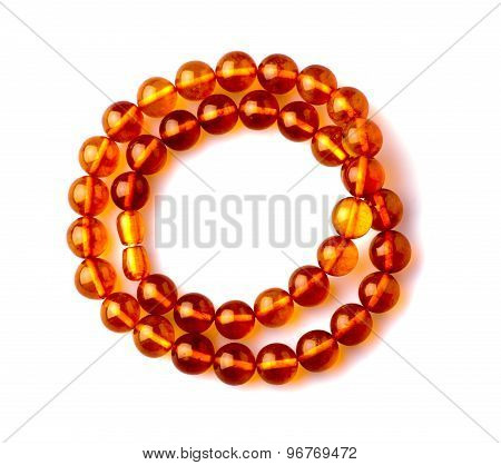 amber beads isolated on white background . poster