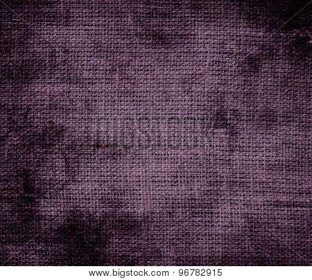 Grunge background of dark byzantium burlap texture