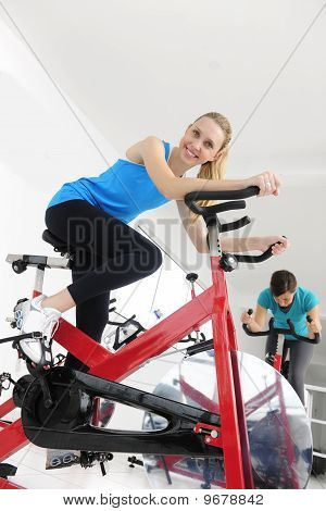 Women Cycling At The Gym
