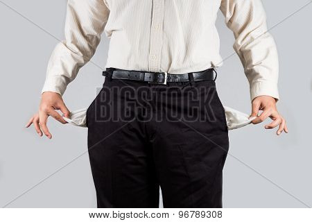 Concept of man pulls out an empty pocket
