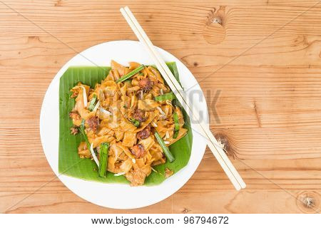 No frills simple Chinese Char Kway Teow or Fried Noodle on banana leaf