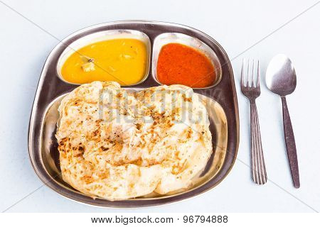 Roti Prata or Roti Canai, a traditional Indian bread served with curry