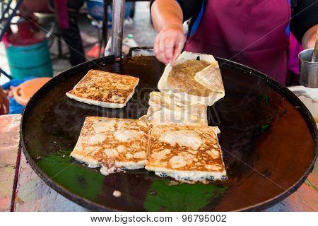 Fried murtabak, a popular local cuisine in Malaysia poster