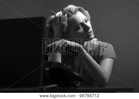 Overworked Female Secretary With Phone