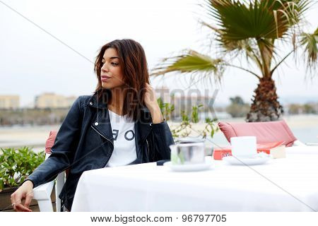 Attractive afro american woman enjoying a good day in restaurant while sitting at the table