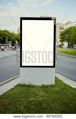 Blank billboard with copy space for your text message or content on flowerbed with green grass