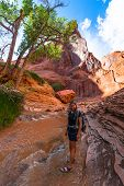 Smiling Girl Hiker looking to the camera Coyote Gulch Escalante poster