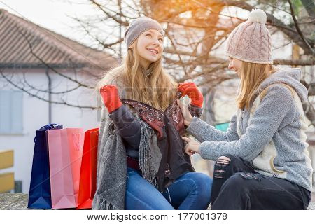 shopping girls best firends try new clothes outdoors