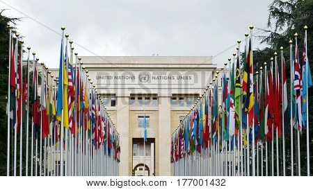 GENEVA, SWITZERLAND - SEPTEMBER 16, 2016: View of the entrance to United Nations (Palace of Nations) and world flags in Geneva, Switzerland. United Nations was established in Geneva in 1947