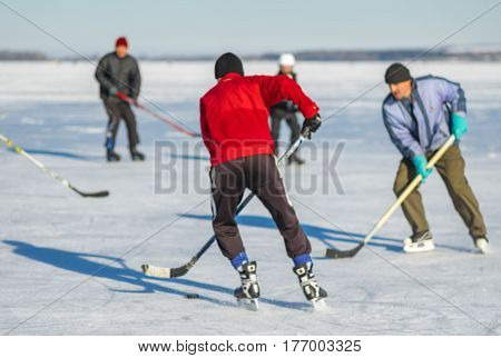 Blurry sport background - Group of men playing hockey on a frozen river Dnepr in Ukraine