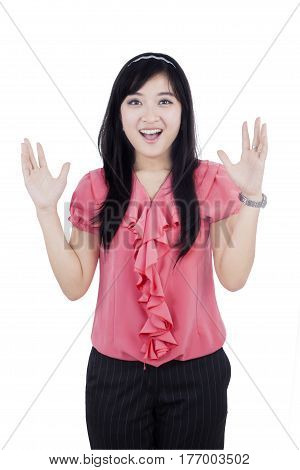 Portrait of a surprised Asian woman in the studio isolated on white background
