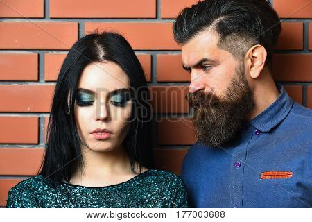 Bearded Man And Pretty Sexy Woman On Brick Wall