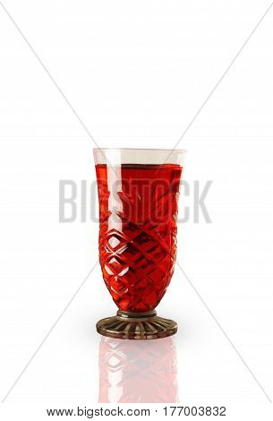 Red sweet refreshing drink in a glass isolated on white