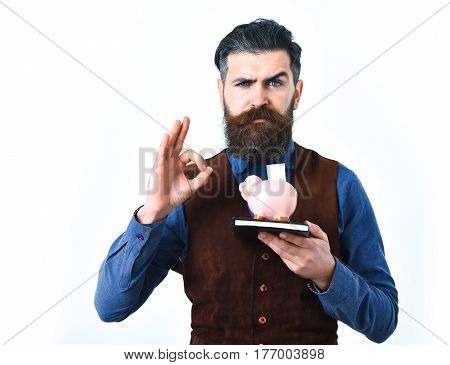 Bearded Man Holding Notepad And Moneybox With Serious Face