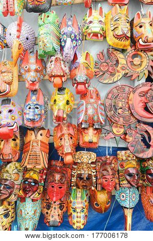Chichicastenango, Guatemala - 4 February 2014: Wooden masks at the market of Chchicastenango on Guatemala