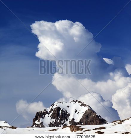 Rocks In Snow And Blue Sky With Clouds