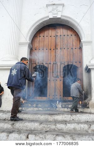 Man Moving Incense At The Church Of Santo Tomas At Chichicastenango