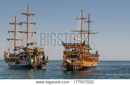 Alanya, Antalya, Turkey. June 25, -2014. Two recreational sailing yachts with tourists, stylized pirate ships on a background of blue sky and sea