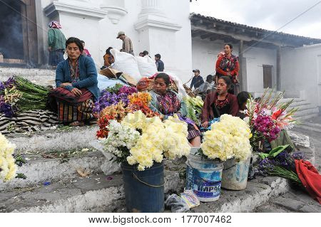 Woman Selling Flowers In Front Of Church Of Santo Tomas At Chichicastenango