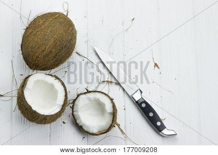 coconut pulp fresh tropical brown white organic coconut milk knife